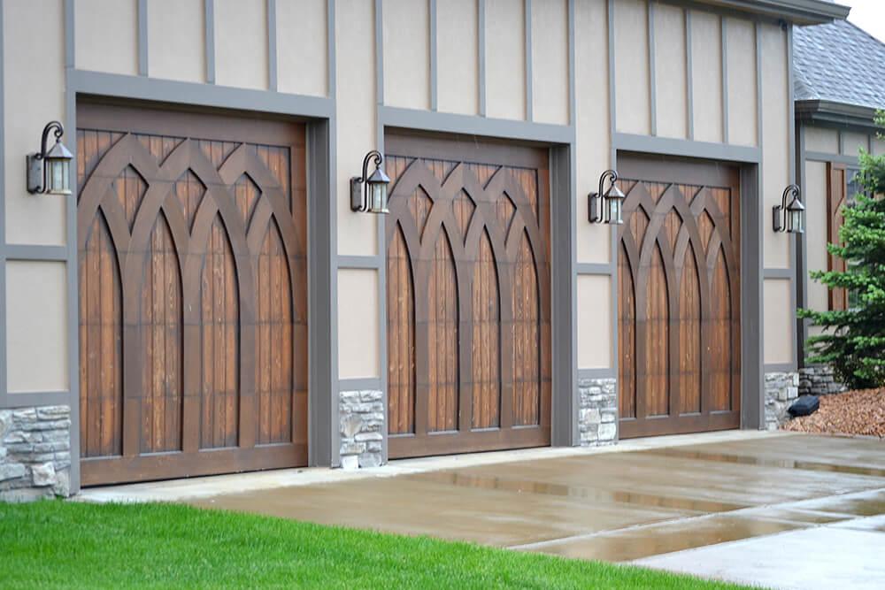 three brown wooden garage doors