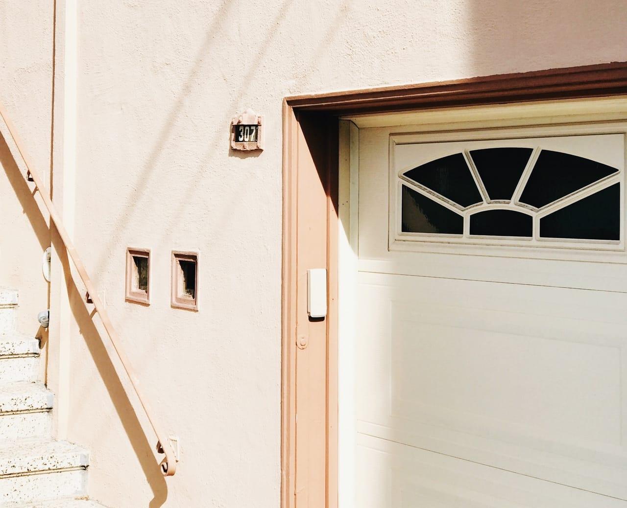 white-garage-door-with-glass-panels