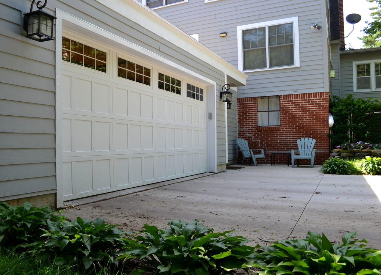 brick-house-with-white-garage-door