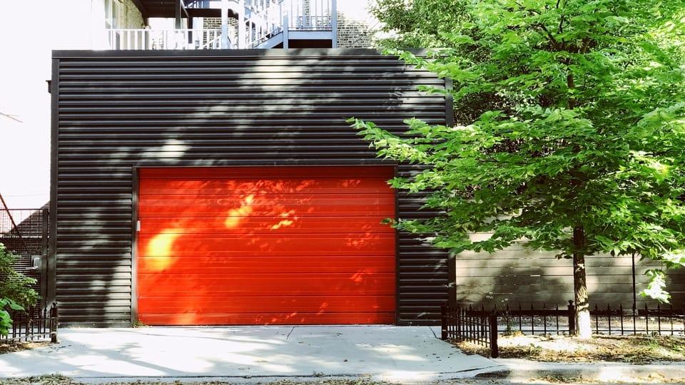 red-garage-door-grey-building