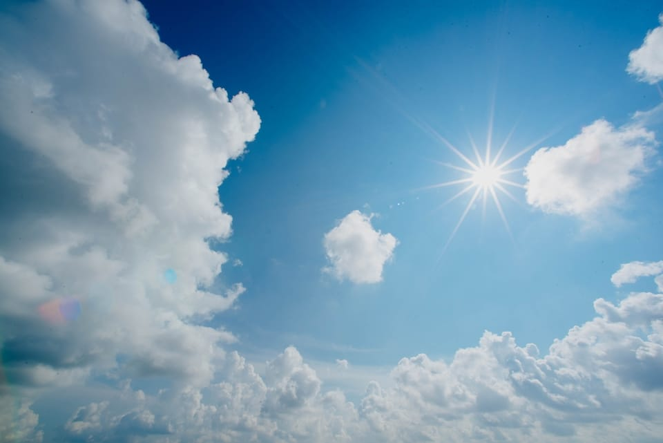 sun-and-clouds-in-blue-sky