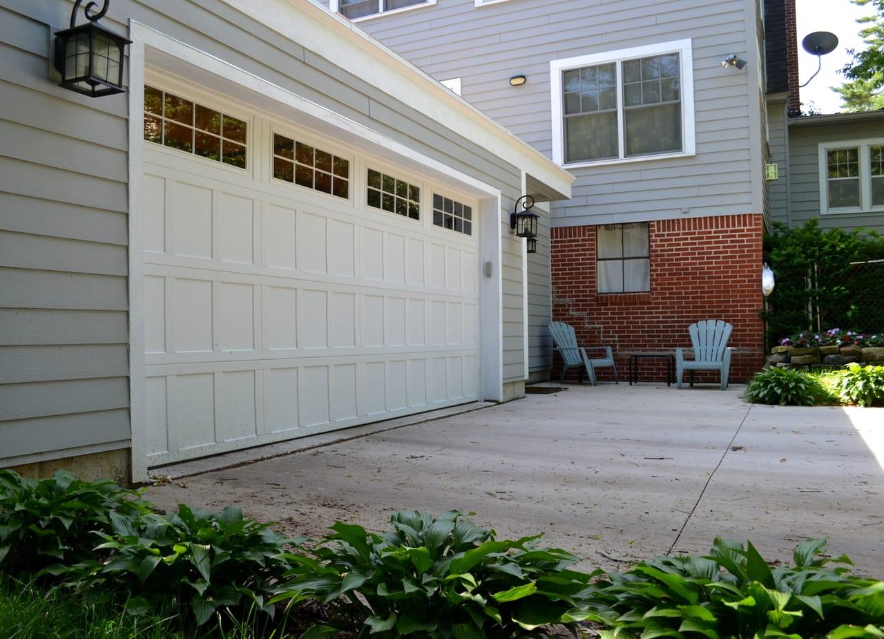 brick-house-with-white-garage-door