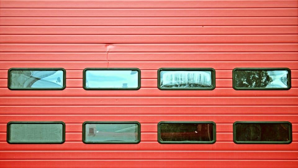 dented-red-garage-door