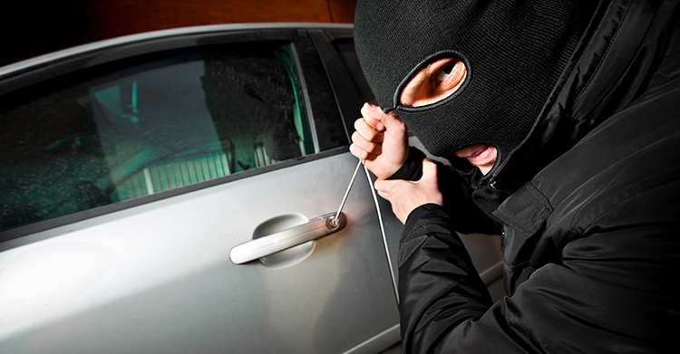burglar-breaking-into-car