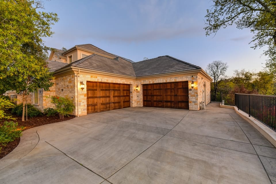 house-with-two-brown-garage-doors