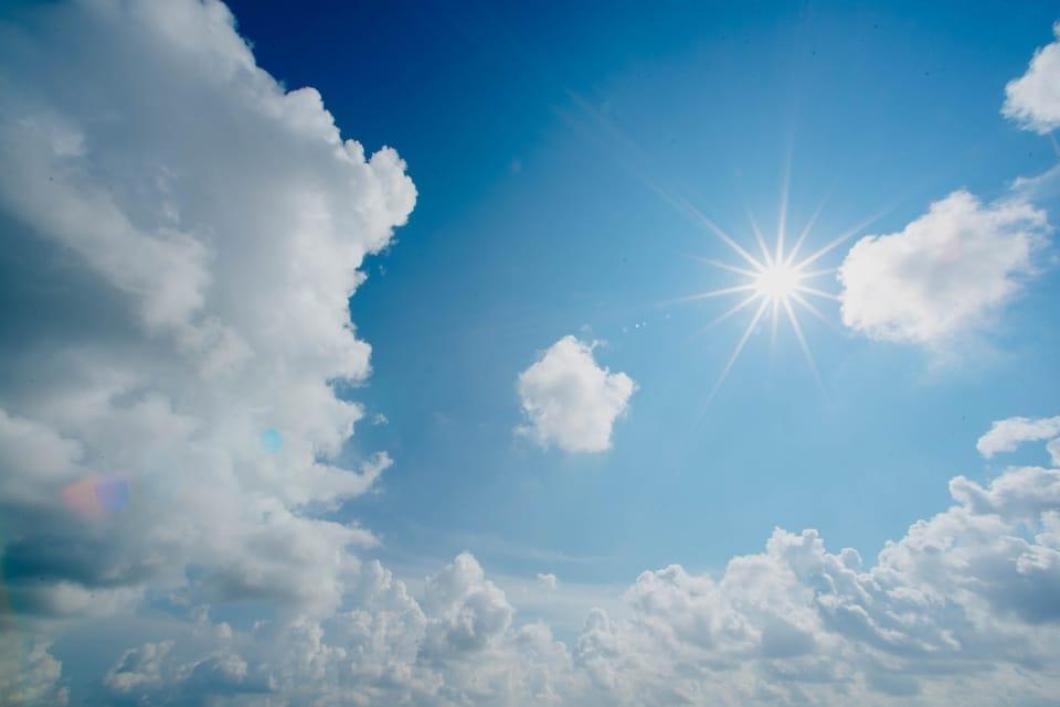 sun-and-clouds-in-blue-sky