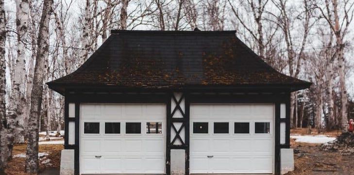 two-garage-doors-with-brown-roof copy